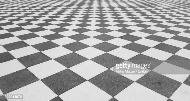 full frame shot of tiled floor - checked pattern stock pictures, royalty-free photos & images