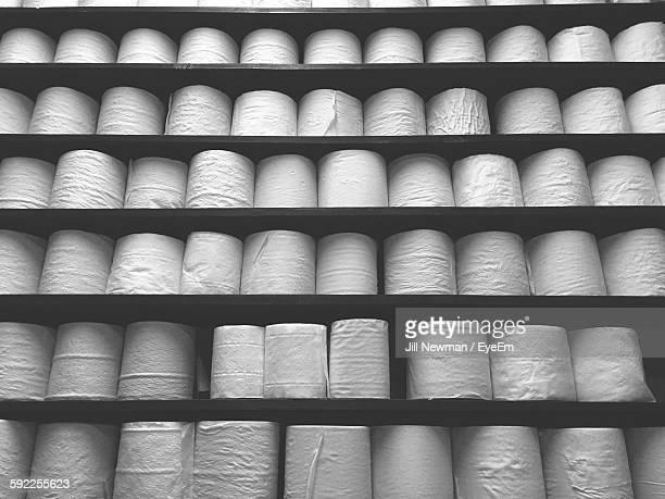 Full Frame Shot Of Toilet Papers On Rack At Shop