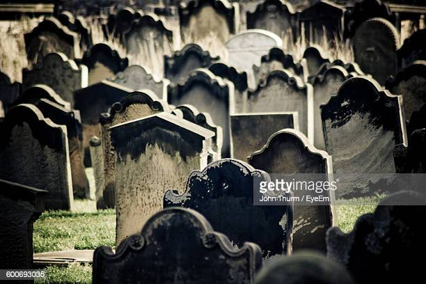 full frame shot of tombstones in graveyard - tombstone stock pictures, royalty-free photos & images