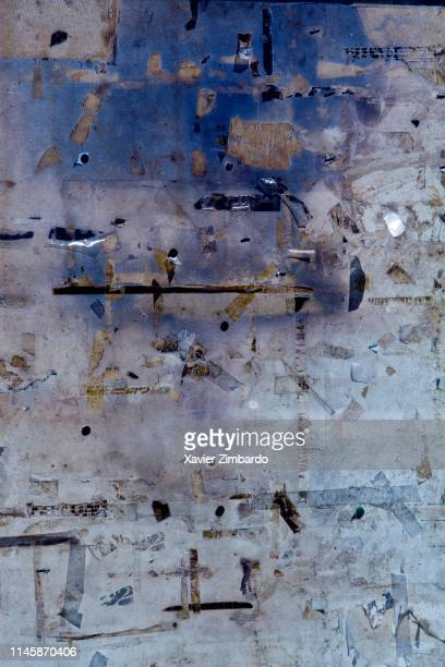 Full frame shot of torn papers on old wall