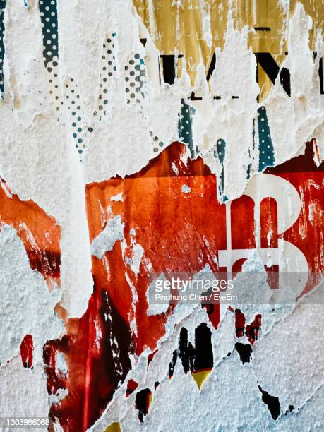 full frame shot of torn posters on wall - torn stock pictures, royalty-free photos & images