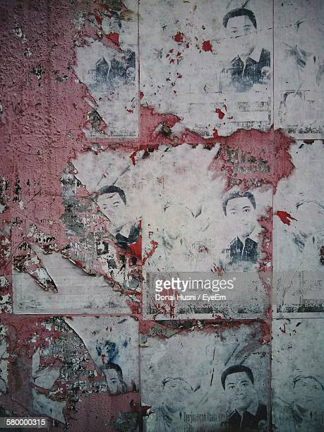 Full Frame Shot Of Torn Posters On Wall
