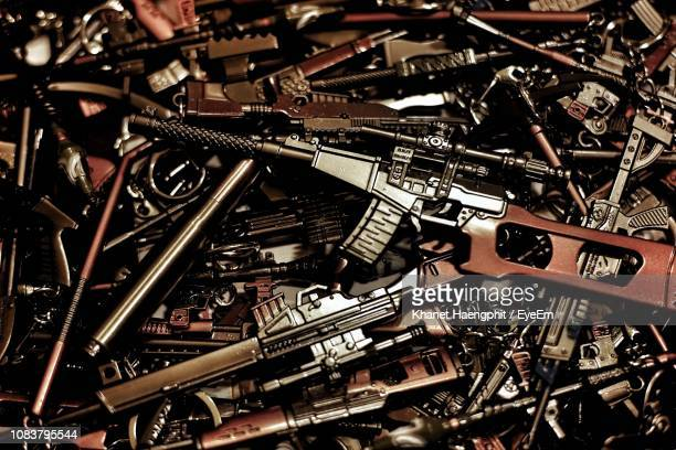 full frame shot of toy weapons - weapon stock pictures, royalty-free photos & images