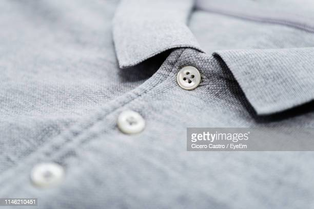 full frame shot of t-shirt - gray shirt stock pictures, royalty-free photos & images