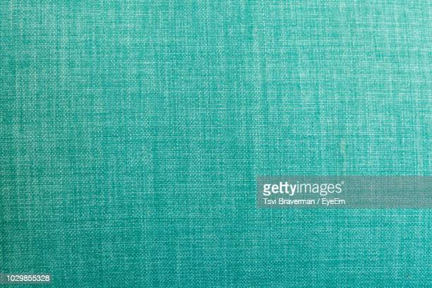 full frame shot of turquoise colored fabric - material têxtil - fotografias e filmes do acervo