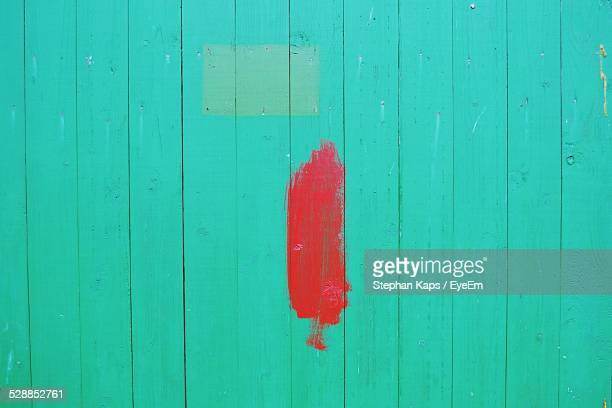 Full Frame Shot Of Turquoise Wooden Wall With Red Paint