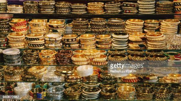 full frame shot of various bangles for sale in store - bangle stock pictures, royalty-free photos & images