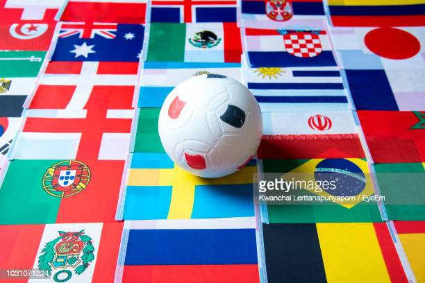 Full Frame Shot Of Various Colorful Flags With Ball