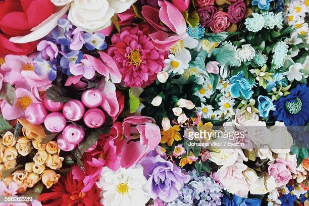 full frame shot of various multi colored artificial flowers at shop - 沢山の物 ストックフォトと画像