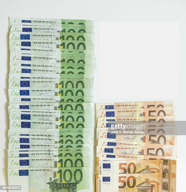 Full Frame Shot of various paper currencies from 100 euros and 50 euros
