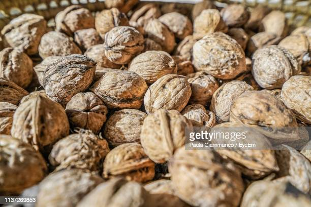 full frame shot of walnuts for sale in store - nutshell stock photos and pictures