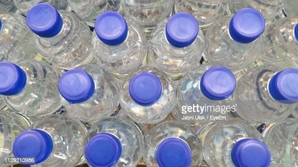 full frame shot of water bottles - cap stock pictures, royalty-free photos & images