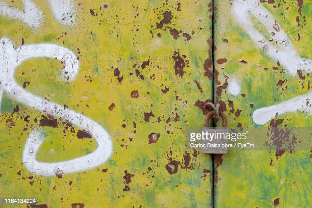 full frame shot of weathered metal door - letter s stock pictures, royalty-free photos & images