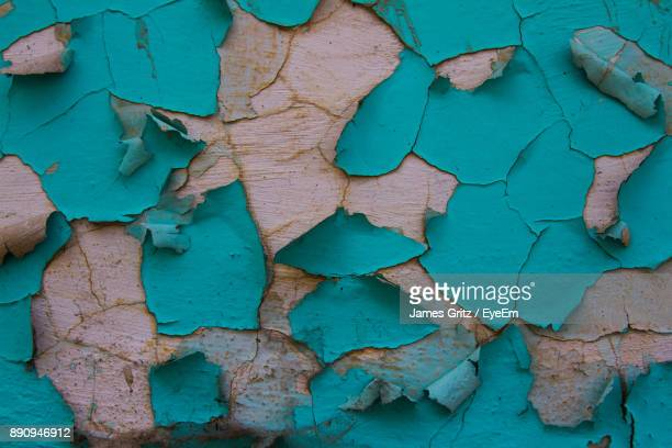 Full Frame Shot Of Weathered Peeled Blue Wall