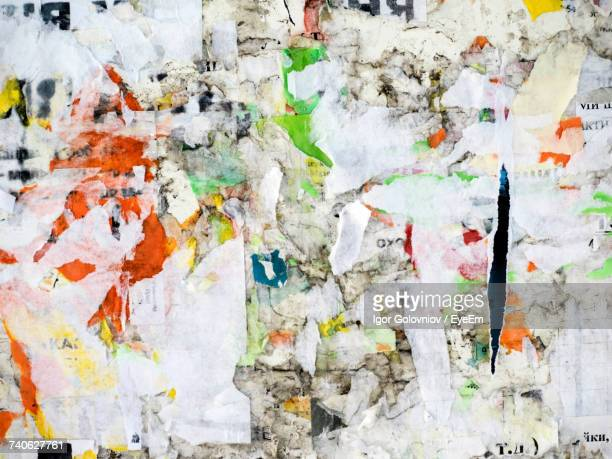 full frame shot of weathered posters on wall - igor golovniov stock pictures, royalty-free photos & images