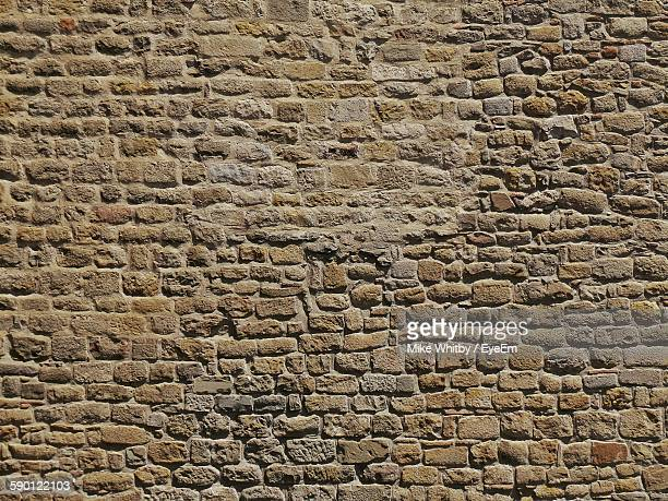 full frame shot of weathered stone wall - stone wall stock pictures, royalty-free photos & images