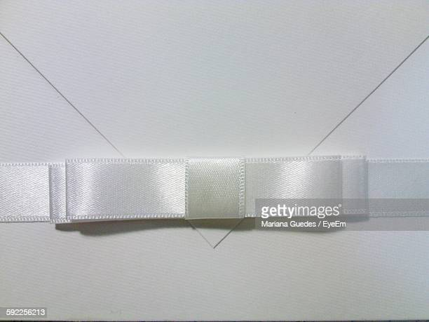 Full Frame Shot Of Wedding Invitation Card With White Ribbon