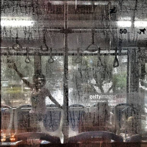full frame shot of wet bus window in rainy season - oppie muharti stock pictures, royalty-free photos & images