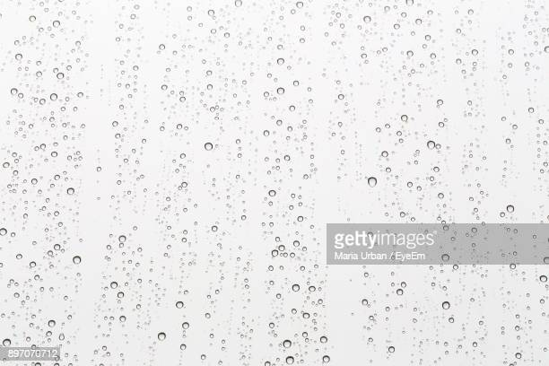 full frame shot of wet glass - rain ストックフォトと画像