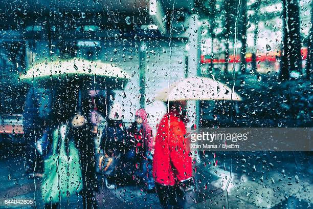 full frame shot of wet glass window during monsoon - torrential rain stock pictures, royalty-free photos & images