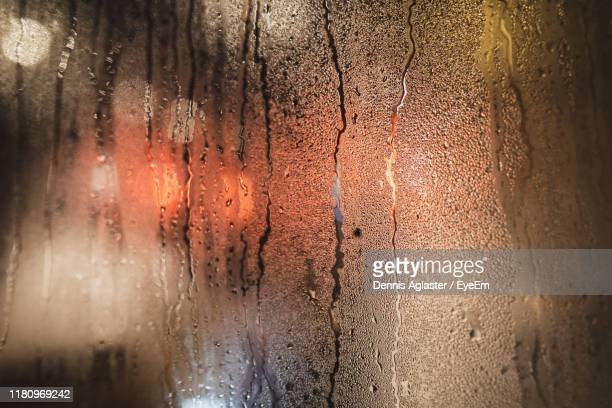 full frame shot of wet glass window - storm dennis stock pictures, royalty-free photos & images