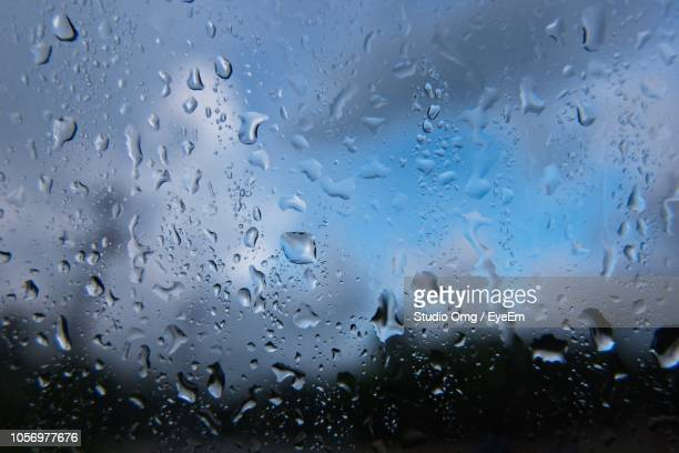 Full Frame Shot Of Wet On Glass Window