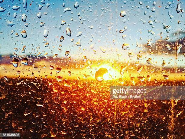Full Frame Shot Of Wet Window At Sunset During Rainy Season