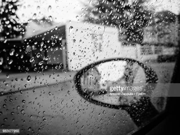 Full Frame Shot Of Wet Window In Car