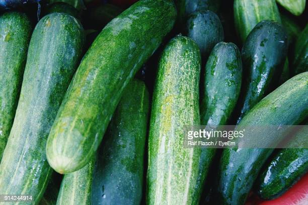 full frame shot of wet zucchinis at market - zucchini stock pictures, royalty-free photos & images