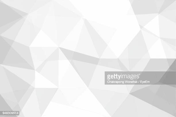 full frame shot of white abstract background - geometrische form stock-fotos und bilder