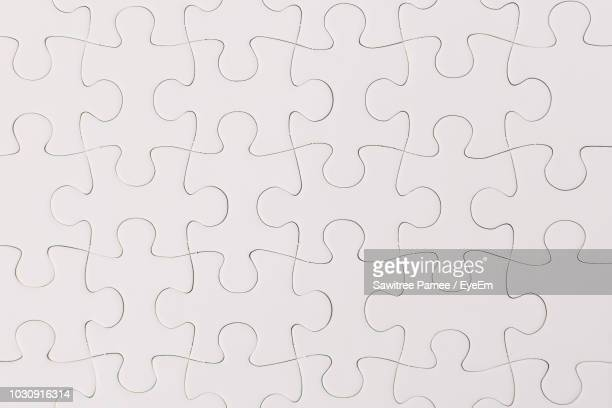 full frame shot of white jigsaw puzzle - puzzle stock pictures, royalty-free photos & images