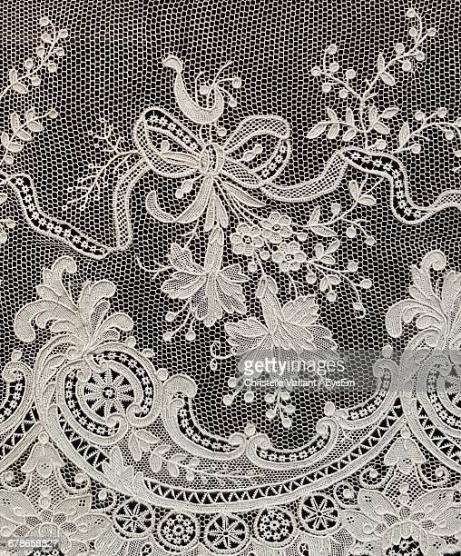 full frame shot of white lacy fabric - frilly stock photos and pictures