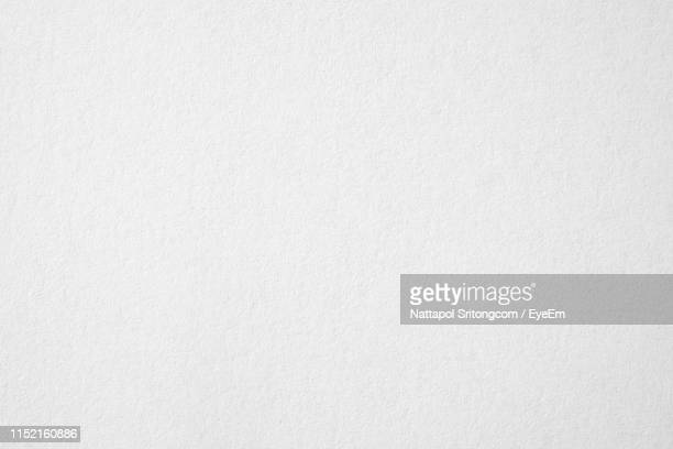 full frame shot of white paper - blanco color fotografías e imágenes de stock