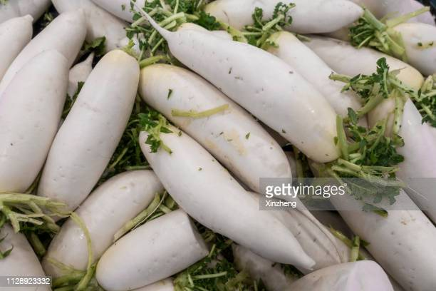 full frame shot of white radish for sale at market - dikon radish stock photos and pictures