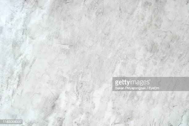 full frame shot of white wall - stone material stock pictures, royalty-free photos & images