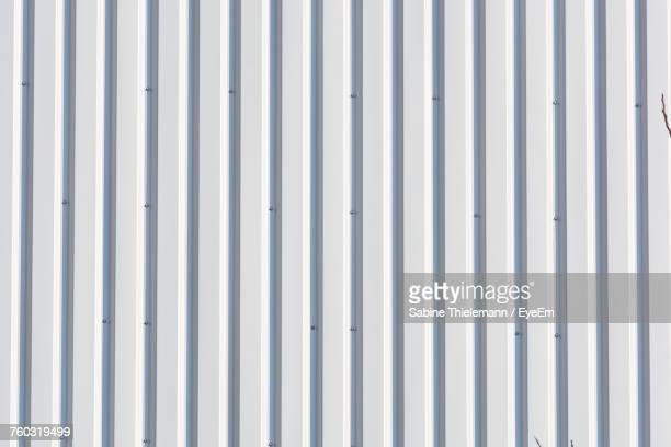 full frame shot of white wall - corrugated iron stock photos and pictures
