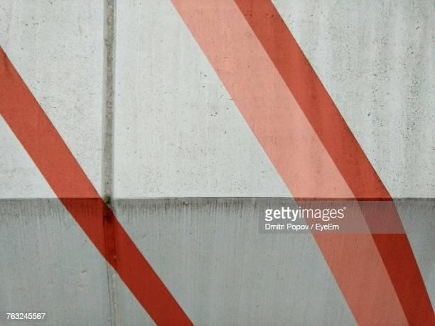 Full Frame Shot Of White Wall With Red Stripes