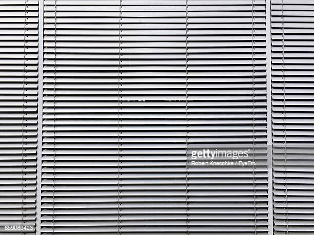 full frame shot of window blinds at home - blinds stock pictures, royalty-free photos & images