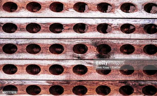 Full Frame Shot Of Wood Plank With Holes
