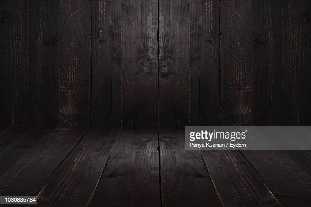 full frame shot of wooden floor and wall - dark stock pictures, royalty-free photos & images