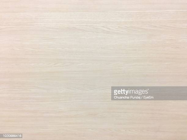 full frame shot of wooden table - beige stock-fotos und bilder