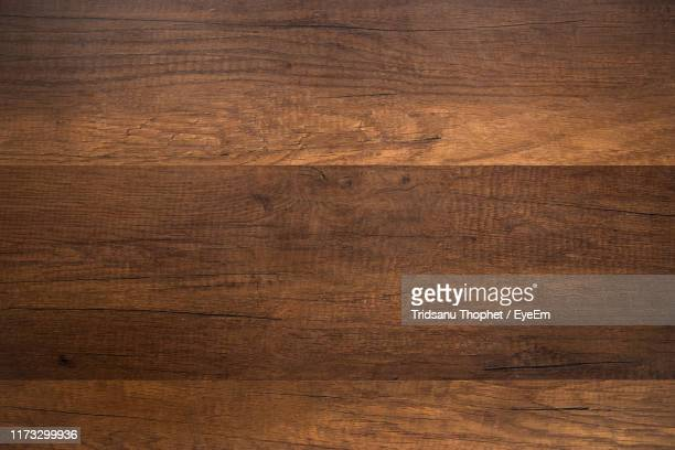 full frame shot of wooden table - wood material stock pictures, royalty-free photos & images
