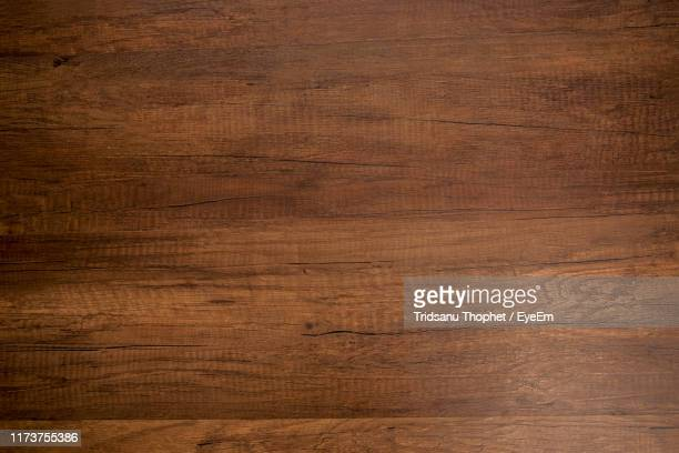 full frame shot of wooden table - brown stock pictures, royalty-free photos & images