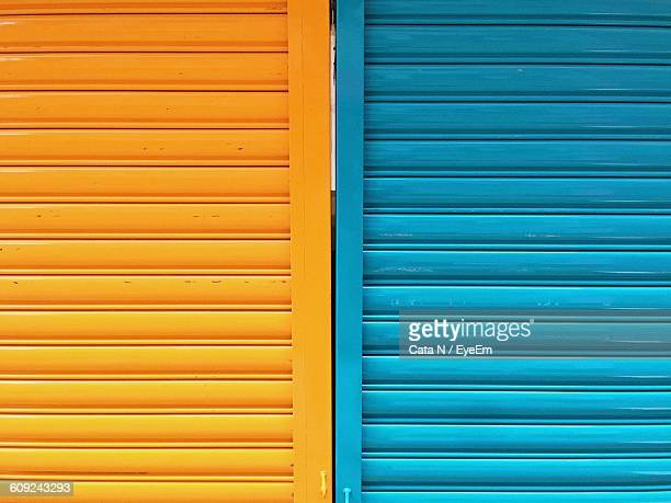 Full Frame Shot Of Yellow And Blue Corrugated Iron