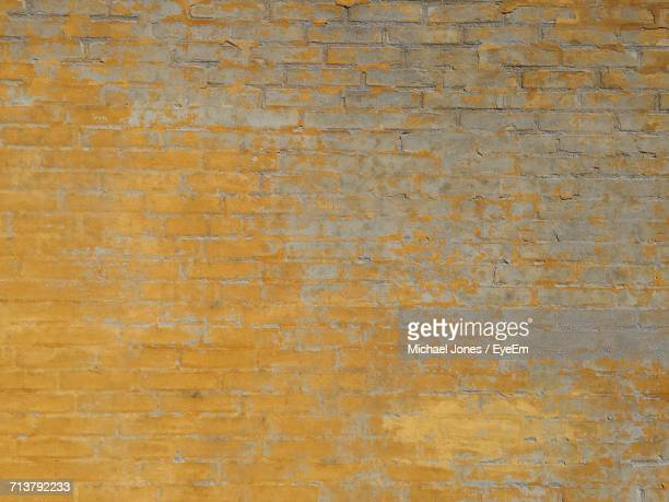 full frame shot of yellow brick wall - michael stock photos and pictures