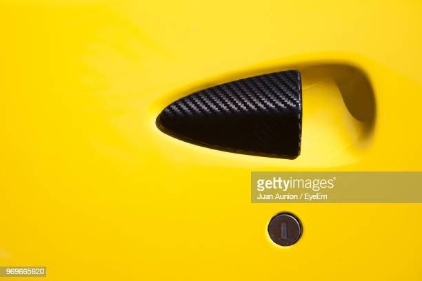 full frame shot of yellow car with handle and lock - handle stock pictures, royalty-free photos & images