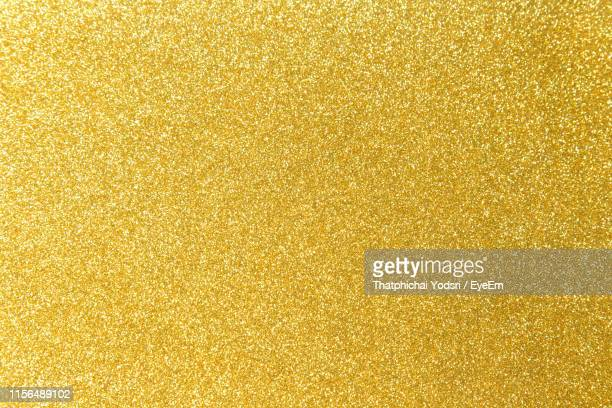 full frame shot of yellow glitter - gold colored stock pictures, royalty-free photos & images