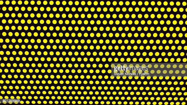 Full Frame Shot Of Yellow Polka Dots On Wall