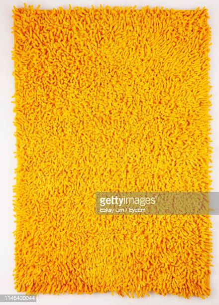 full frame shot of yellow rug against white background - rug stock pictures, royalty-free photos & images