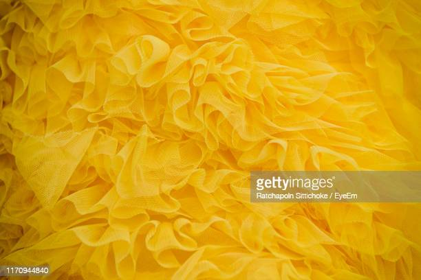 full frame shot of yellow tulle netting - tulle netting stock pictures, royalty-free photos & images
